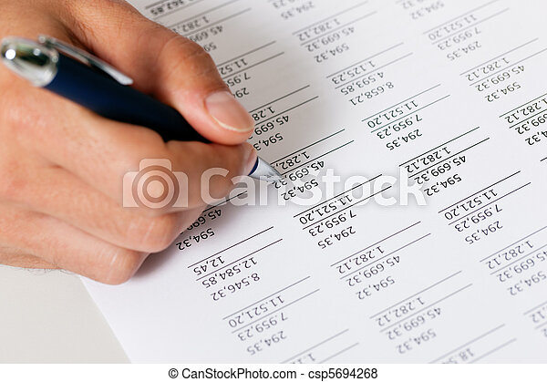 Accountant working on numbers - csp5694268