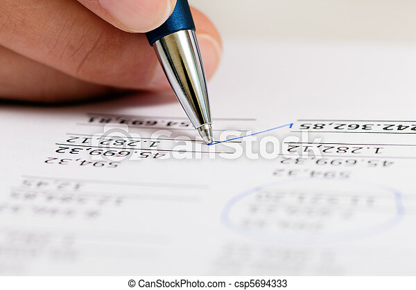 Accountant working on numbers - csp5694333