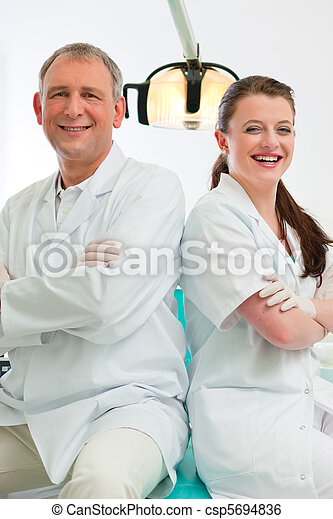 Dentists in their surgery - csp5694836