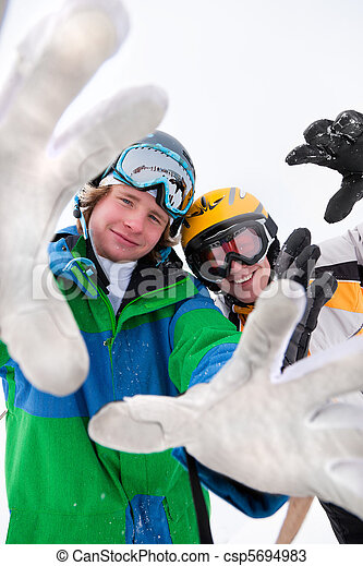 Skier and snowboarder in the snow - csp5694983