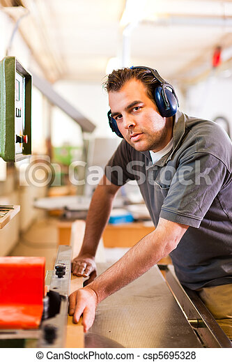 Carpenter with electric cutter - csp5695328