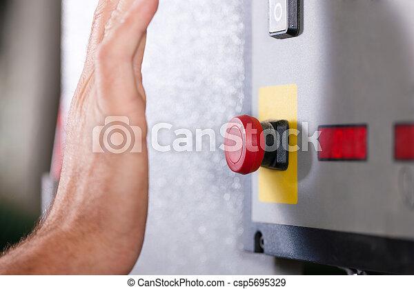 Emergency ? Man shutting machine of - csp5695329