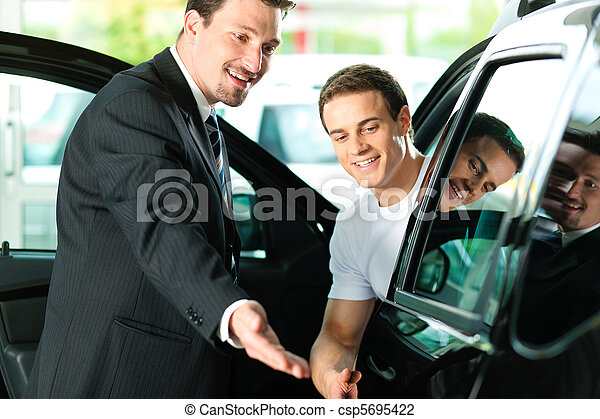Man buying car from salesperson - csp5695422