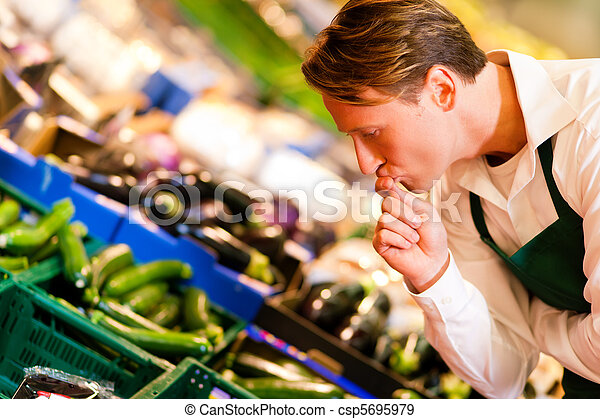 Man in supermarket as shop assistant - csp5695979