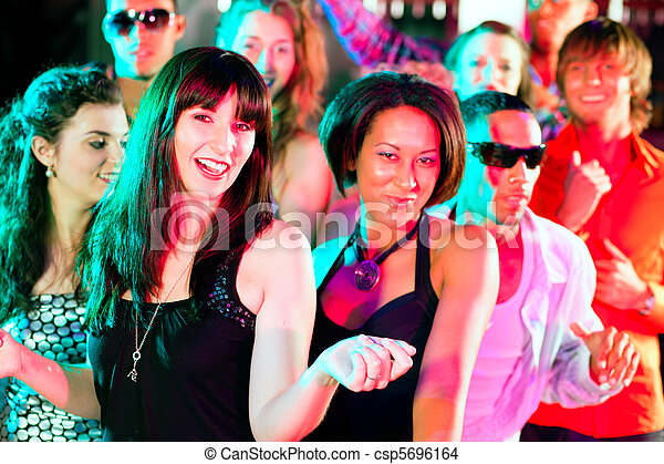 Friends dancing in club or disco - csp5696164