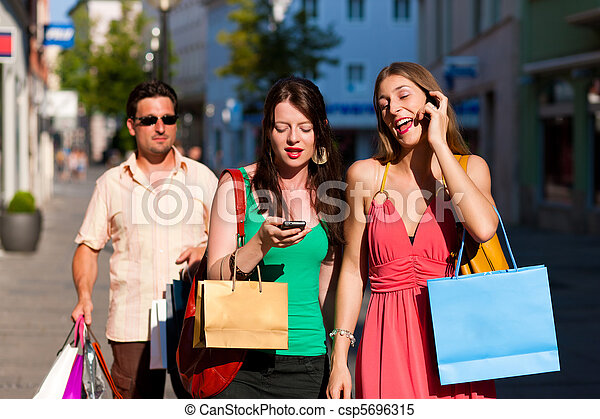 women downtown shopping with bags - csp5696315