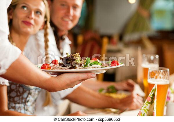 Waitress serving an Bavarian Restaurant - csp5696553