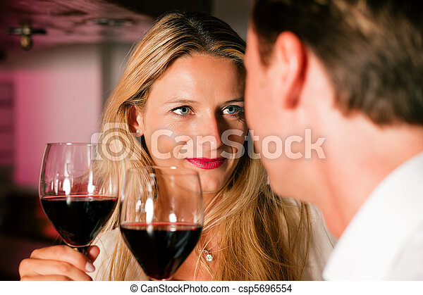 Casual Businesspeople flirting in hotel bar - csp5696554