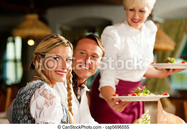 Waitress serving an Bavarian Restaurant - csp5696555