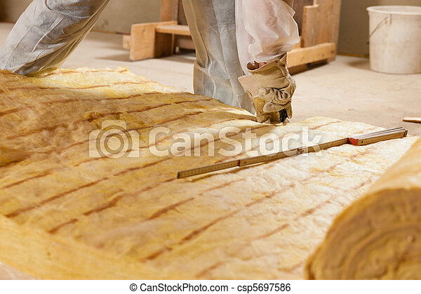 Man cutting insulation material for building - csp5697586