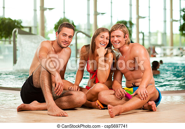 Three friends in public swimming pool - csp5697741