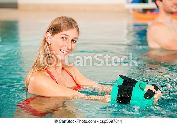 Aquarobics or hydrotherapy in spa - csp5697811