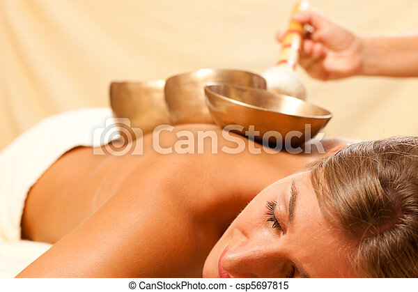 Woman and Wellness with singing bowls - csp5697815