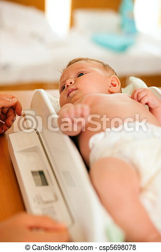 Baby on weight scale - csp5698078
