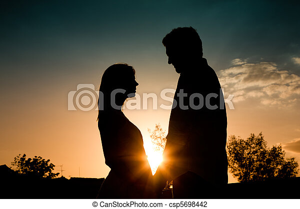 Love - sunset couple embracing each other - csp5698442
