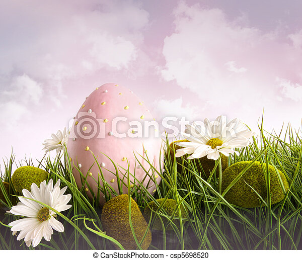 Large pink easter with flowers in tall grass - csp5698520