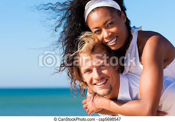 Couple on sunny beach in summer - csp5698547