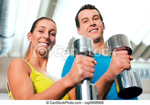 Gym training with dumbbells - csp5698668