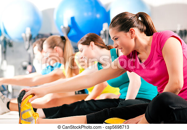 People in gym warming up stretching - csp5698713