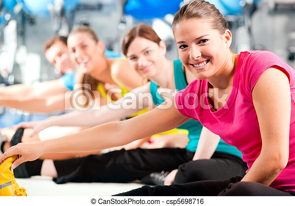 People in gym warming up stretching - csp5698716