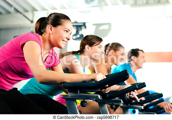 Indoor bycicle cycling in gym - csp5698717