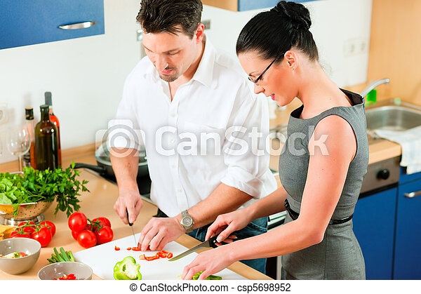 Couple cooking together in kitchen - csp5698952