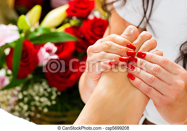 Woman in nail studio receiving foot massage - csp5699208