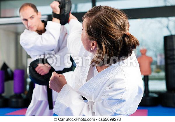 Martial Arts sport training in gym - csp5699273