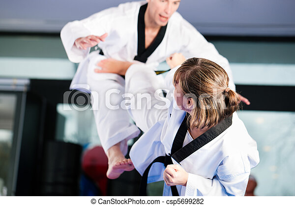 Martial Arts sport training in gym - csp5699282