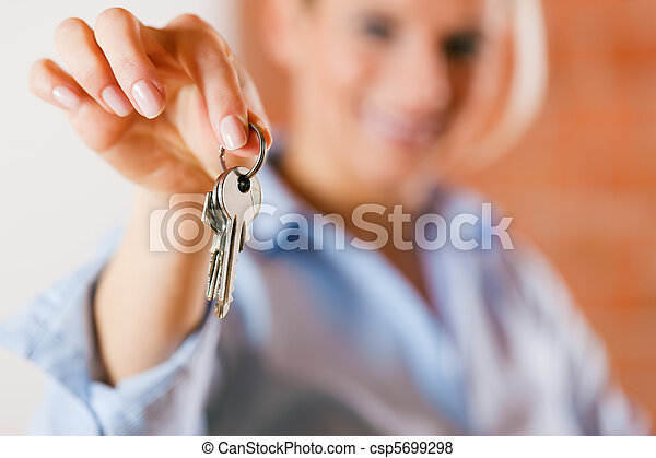 Realtor in empty apartment giving keys - csp5699298