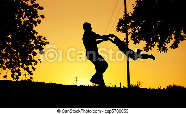 Father and son playing at sunset - csp5700053
