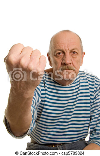 The elderly man threatens with a fist - csp5703824