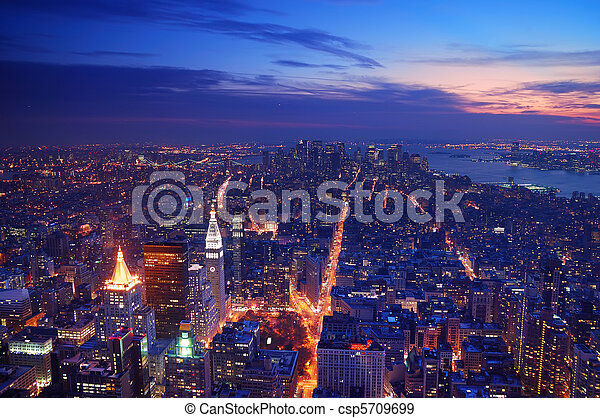New York City Manhattan skyline aerial view panorama at sunset  - csp5709699