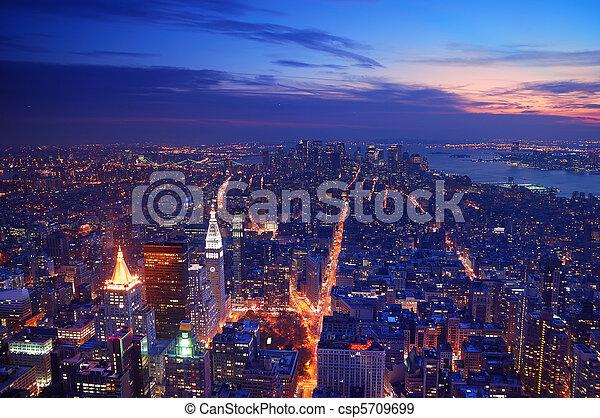 New York City Manhattan skyline aerial view panorama at sunset  - csp5709699