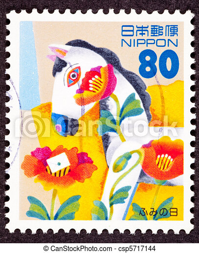 Stamp commemorating National Letter Writing Day with a letter on top of tulip and a wildly decorated wooden horse - csp5717144