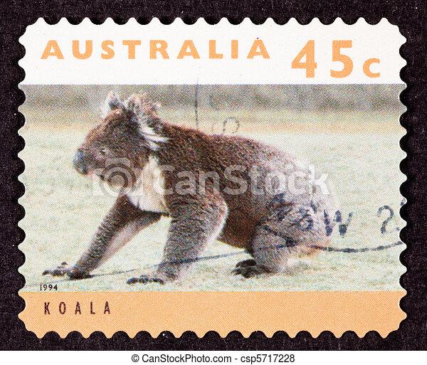 Canceled Australian Postage Stamp Koala Bear Sitting on Grassy Ground - csp5717228