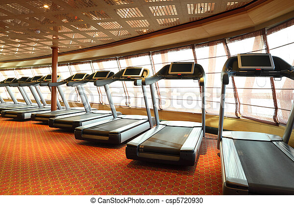 large gym hall with treadmills near windows in cruise ship - csp5720930