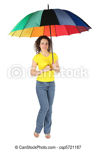 young beauty woman with toothy smile in yellow shirt with multicolored umbrella standing isolated on white - csp5721187