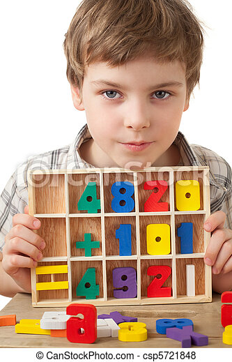 boy in checkered shirt plays in wooden figures in form of numerals isolated on white background - csp5721848