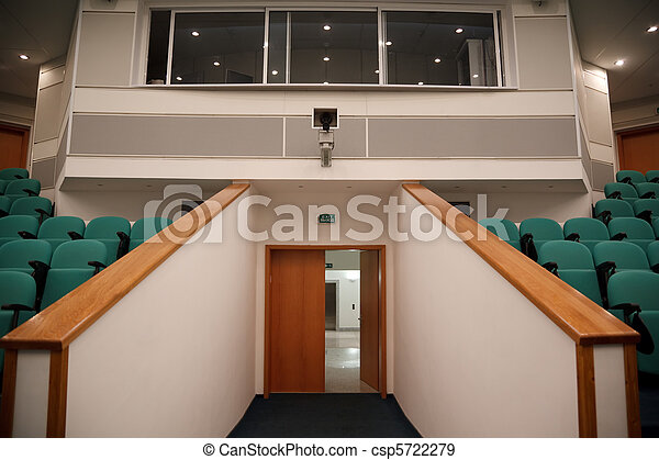 Interior of hall for conferences. Rows of chairs for spectators. View of the entrance to the hall. - csp5722279