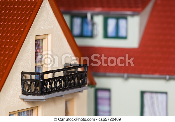 toy plastic house with an extension and balcony - csp5722409