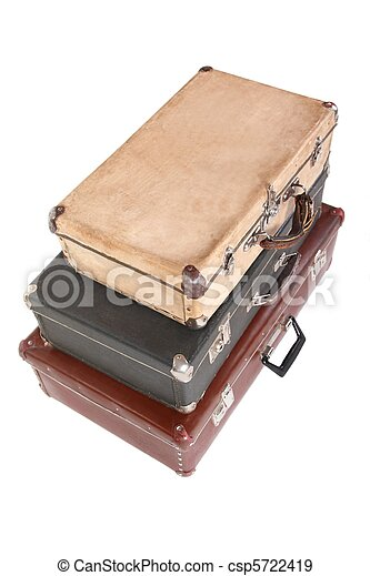 three old dirty dusty suitcases. all suitcases is closed. Isolated. focus on front corner of yellow suitcase. - csp5722419