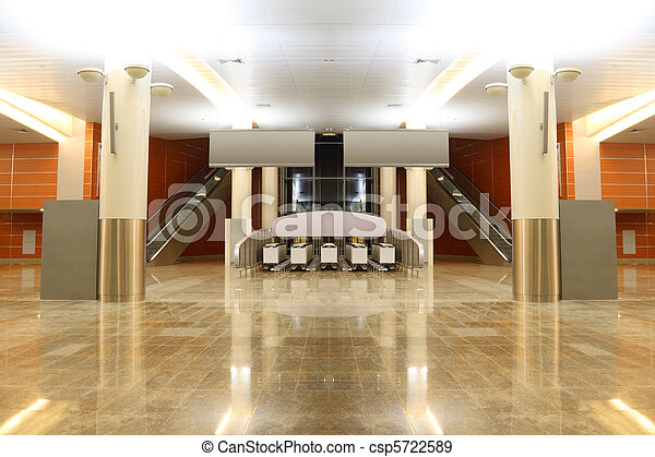 big modern hall with granite floor, columns and two escalators in airport, general view - csp5722589