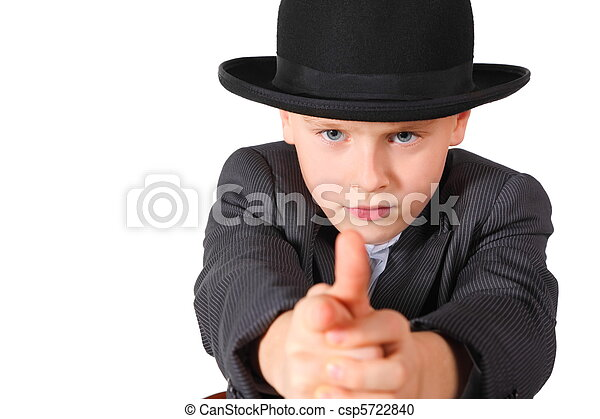handsome little boy wearing suit and hat is playing gangster. isolated. - csp5722840