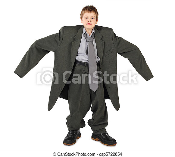 little boy in big grey man's suit and boots nads at sides isolated on white background - csp5722854