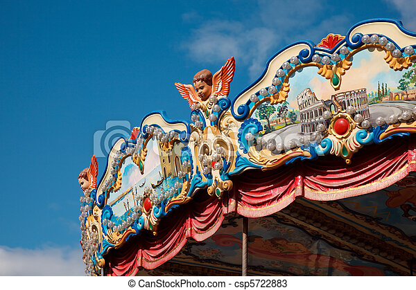 Amusement park - piece of roof of carousel, richly decorated with bright ornaments. - csp5722883