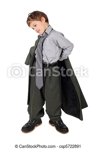 little boy in big grey man's suit and boots dressing jacket isolated on white background - csp5722891