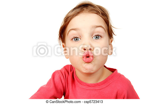 Portrait of girl in pink shirt on white background. She looks into camera, lips depicting kiss. Isolation. - csp5723413