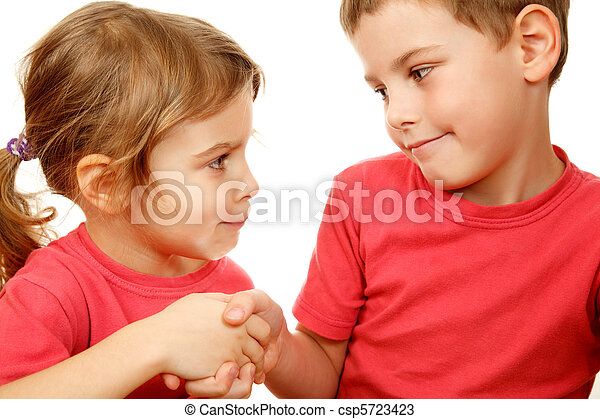 Brother and sister in pink shirts with smile shake hands. Fake smile, bad peace is better than a good war. - csp5723423