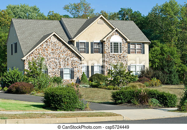 Stock photographs of modern stone faced single family for Stone faced houses